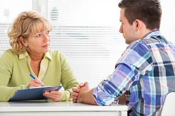 Woman counsellor with male patient
