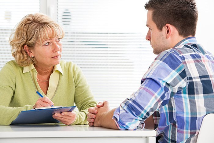 woman counsellor with male client