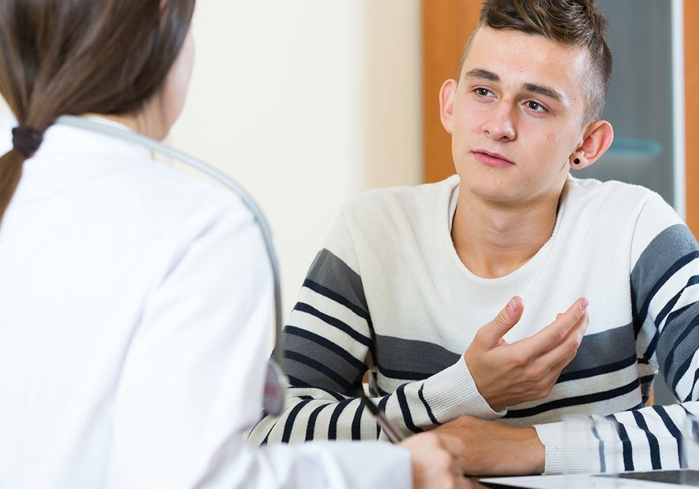 Young man listening to nurse